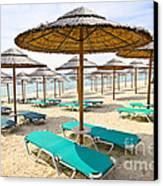 Beach Umbrellas On Sandy Seashore Canvas Print by Elena Elisseeva