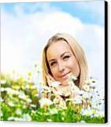 Beautiful Woman Enjoying Daisy Field And Blue Sky Canvas Print by Anna Omelchenko