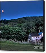 Blue Moon Canvas Print by Guy Harnett