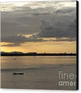 Boat On River At Sunset Canvas Print by Nawarat Namphon
