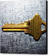 Brass Key On Stainless Steel. Canvas Print by Ballyscanlon