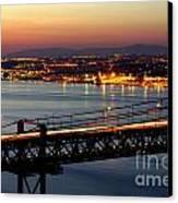 Bridge Over Tagus Canvas Print by Carlos Caetano