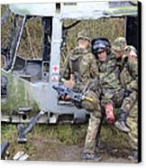 British Soldiers Help A Simulated Canvas Print by Andrew Chittock
