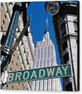 Broadway Sign And Empire State Building Canvas Print by Axiom Photographic