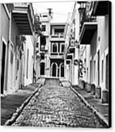 Calle De Guijarro Canvas Print by John Rizzuto