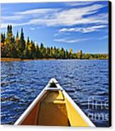 Canoe Bow On Lake Canvas Print by Elena Elisseeva