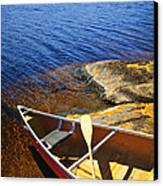 Canoe On Shore Canvas Print by Elena Elisseeva