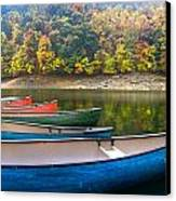 Canoes At Fontana Canvas Print by Debra and Dave Vanderlaan