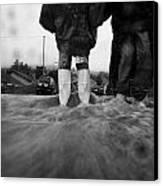 Children Walking In Heavy Rain Storm In The Street Canvas Print by Joe Fox
