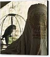 Close-up Of A Woman And A Parakeet - Canvas Print by James L. Stanfield