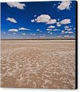 Clouds Float In A Blue Sky Above A Dry Canvas Print by Jason Edwards