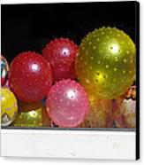 Colorful Balls In The Shop Window Canvas Print by Ausra Huntington nee Paulauskaite