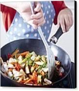 Cooking A Stir Fry Canvas Print by Veronique Leplat