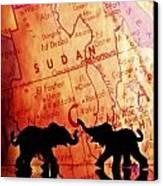 Elephant Silhouettes In Front Of A Map Canvas Print by Chris Knorr