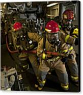 Firemen Combat A Simulated Fire Aboard Canvas Print by Stocktrek Images