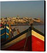 Fishing Boats In Front Of Kasbah Des Canvas Print by Axiom Photographic