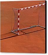 Football Net On Red Ground Canvas Print by Daniel Kulinski