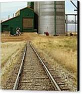 Grain Silos And Railway Track Canvas Print by Tony Craddock