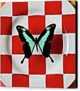 Green And Black Butterfly On Red Checker Plate Canvas Print by Garry Gay