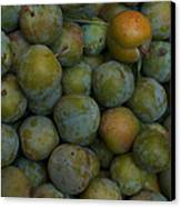 Green Plums Fill A Bin Outside A Local Canvas Print by Heather Perry