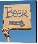 Hand Holding Up Makeshift 'beer' Sign Canvas Print by Pete Starman