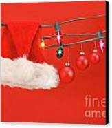 Hanging Lights With Santa Hat Canvas Print by Sandra Cunningham