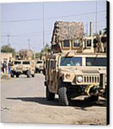 Humvees Conduct Security Canvas Print by Stocktrek Images