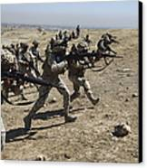 Iraqi Army Soldiers Move To Positions Canvas Print by Stocktrek Images