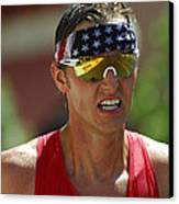 Ironman On The Run Canvas Print by Bob Christopher