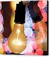 Light Bulb And Bokeh Canvas Print by Setsiri Silapasuwanchai