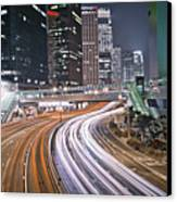 Light Trails On Road Canvas Print by Andi Andreas