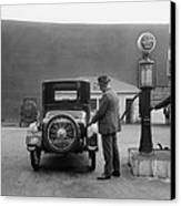 Man Fueling His Car At A Self-service Canvas Print by Everett