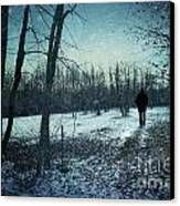 Man Walking In Snow At Winter Twilight Canvas Print by Sandra Cunningham