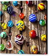 Marbles On Wooden Board Canvas Print by Garry Gay