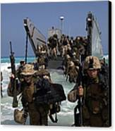 Marines Disembark A Landing Craft Canvas Print by Stocktrek Images