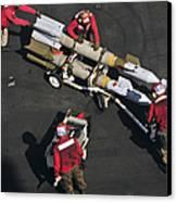 Marines Push Pordnance Into Place Canvas Print by Stocktrek Images