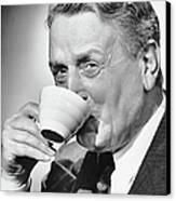 Mature Man Drinking Cup Of Coffee Canvas Print by George Marks