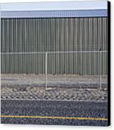 Metal Storage Shed Behind Fence Canvas Print by Paul Edmondson