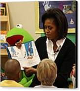 Michelle Obama Reads The Cat In The Hat Canvas Print by Everett