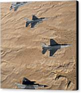 Military Fighter Jets Fly In Formation Canvas Print by Stocktrek Images