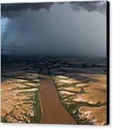 Monsoon Rains Over A Muddy River Canvas Print by Randy Olson