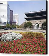 Namdaemun Gate With Flowers In Foreground Canvas Print by Jeremy Woodhouse