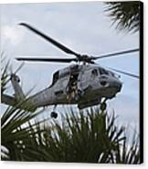 Navy Seals Look Out The Helicopter Door Canvas Print by Michael Wood