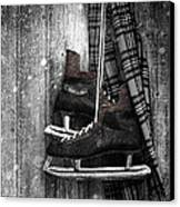 Old Ice Skates Hanging On Barn Wall Canvas Print by Sandra Cunningham