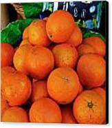 Oranges Displayed In A Grocery Shop Canvas Print by Sami Sarkis