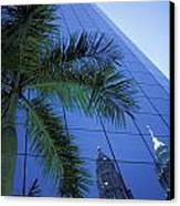 Palm Tree And Reflection Of Petronas Canvas Print by Axiom Photographic