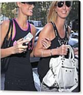 Paris Hilton, Nikki Hilton Carrying Canvas Print by Everett