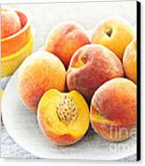 Peaches On Plate Canvas Print by Elena Elisseeva