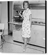 Portrait Of Woman Cooking In Kitchen Canvas Print by George Marks