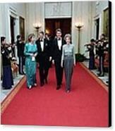 President And Nancy Reagan Walking Canvas Print by Everett
